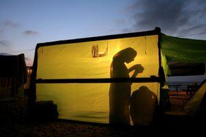 Shirat Hayam, Jul 05 - Jewish settler during evening prayer in her hut © Natan Dvir