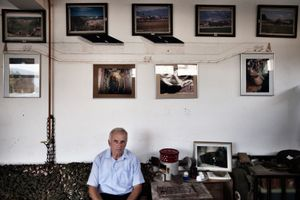 Bajro Kolar is sitting on a couch in his private Tunnel museum near Sarajevo. The entrance of the tunnel on the Butmir side near the airport was the house which belonged to his family. The Tunnel was constructed to allow food and humanitarian aid, as well as war supplies to come into the city. In fact more people wanted to enter Sarajevo through the Tunnel, rather than to escape .© Ole Elfenkämper