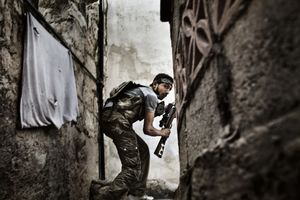 2nd Prize Spot News Stories © Fabio Bucciarelli, Italy, Agence France-Presse.  10 October 2012, Aleppo, Syria. A Free Syrian Army fighter takes up a position during clashes against government forces in the Sulemain Halabi district.