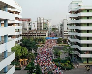 Manufacturing #2, Shift Change, Yuyuan Shoe Factory, Gaobu Town, Guangdong Province, 2004 © Edward Burtynsky