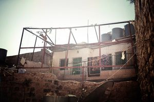 Palestinian home in Hebron protected from settlers across the road with a cage of chicken wire. July 2011 © Lars Håberg