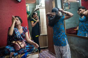 Husna, Manisha and Gomzi in the home they share near King's Circle Station in Mumbai  © Alison McCauley