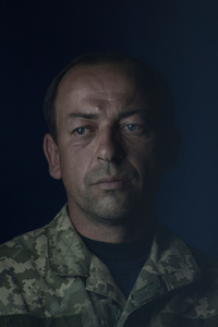 Ihor, 37, driver, picture was taken after he spent 12 months in the war zone, July 2015, Ukraine.