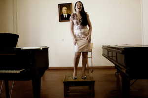 An Armenian pop singer rehearses at the National Conservatory of Tashkent.