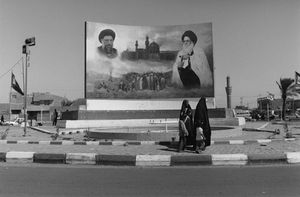 "Iraq. Entrance to the former Saddam City, Baghdad. 2003. From the book ""War Photographer: Between Shadow and Light"" © Christine Spengler"