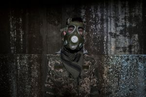 A stalker dons a mock gas mask