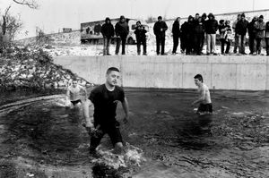 FYROM-Serbian borders. Orthodox celebrate Theophany Day throwing the cross into the frozen river.