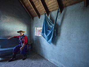 Gauchito Gil devotee at rest,  in the temple of the popular saint in El Campito de la Carolina