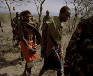 Oldonyiro, northern kenya, poachers are led from the bush by conservancy rangers-from the series 'with butterflies and warriors'-David Chancellor
