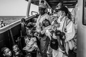 MOAS rescue team with an African child