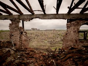 View of destroyed Donetsk airport from the ruins of the Iversky monastery. A graveyard lies in between.