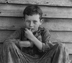 "Floyd Burroughs Jr., son of Floyd. Photo from ""Let Us Now Praise Famous Men."" © Walker Evans. Published by Houghton Mifflin Company"