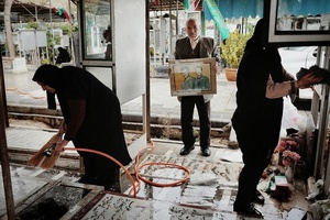 The families of the martyrs visit and cleans their graves weekly and also on special and important occasions like on Noruz, the iranian new year. They belive that their sons are still alive and need to have a clean home. Furthermore this calming (ritual/)routine helps them to keep the memories of their martyrs present.