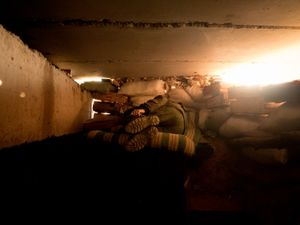 A separatist soldier sleeping after a night of shelling in the area of Adveevka.