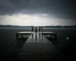 In your youth, nothing can stop you from enjoying time with your friends, especially not a simple matter of rain during summer fun. You may grow up and forget the names, but you'll always remember the moments, the time on the dock with your friends during a surprise shower © Samantha Fortenberry, United States. Shortlist, Low Light, Open Competition. 2014 Sony World Photography Awards