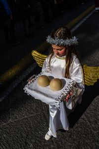 A child disguised as angel bears the breast of Sant'.Agata in Catania