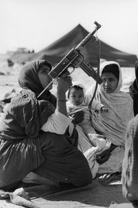 "The Western Sahara. Women in training. 1976. From the book ""War Photographer: Between Shadow and Light"" © Christine Spengler"