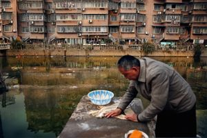 Several villagers along the Fenghua river in Ningbo have no choice but to use the polluted water for bathing, washing food and clothes etc. Over the past 10 years 95 residents have been reported as fatal victims of cancer  in the nearest village at Rongjianqui, Yinzhou. The settlement has a population of 600. ©Souvid Datta
