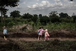 Mwanje, Semabulia and Sekiringa on their way to the local school about five minutes walk through the village