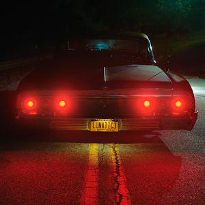 Romeo's Impala. A member of the Lunatics Lowrider Club.