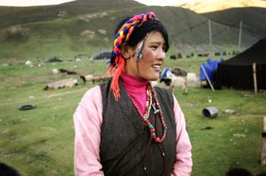 Nomad woman outside her family's encampment at elevation 16,300 feet between Lhasa and Bayi. © Forest McMullin