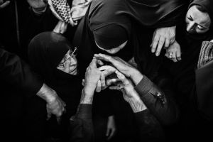 Khadija Shabani (64) mother of Martyr H. Khalili after 31 years waiting ..  in last moment  looking at a piece of bone is her son _ Tehran
