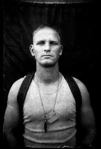 """KABUL PORTRAITS. """"Private first class Mark, driver"""". Portraits of Dutch ISAF troops in Kabul, Afghanistan. The photos are taken with the antique box camera, borrowed from an Afghan street photographer in Kabul. The exposure time of each photo was 10 seconds."""