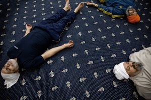 Sikh yoga   Men partake in breathing exercises during their weekly yoga class on the Gurdwara hall floor. The Sikh instructors classes are very popular in Birminghams Gurdwaras.  © Liz Hingley