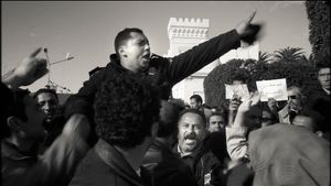 Tunis, Tunisia (2011). Watershed. A policeman who just joined the demonstrators leads the crowd to besiege Government House.