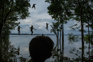 Indigenous Munduruku children play in the Tapajos river in the tribal area of Sawre Muybu, Itaituba, Brazil on 10 February 2015.