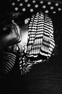 An addict covered with a piece of cloth takes a nap in the afternoon.© Gazi Nafis Ahmed